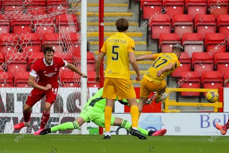 Aberdeen goalkeeper and Captain Joe Lewis (1) saves a shot from Scott Robinson (17) of Livingston during the Scottish Premiership match between Aberdeen and Livingston at Pittodrie Stadium, Aberdeen