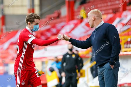 Aberdeen midfielder Scott Wright (25) shakes hands with Livingston Manager Gary Holt during the Scottish Premiership match between Aberdeen and Livingston at Pittodrie Stadium, Aberdeen