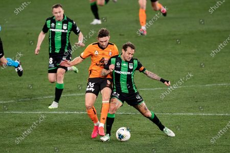 Western United midfielder Alessandro Diamanti (23) and Brisbane Roar midfielder James O'Shea (26) collide