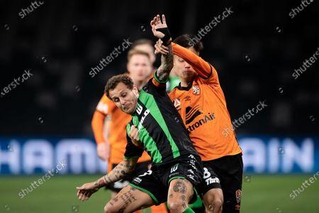 Western United midfielder Alessandro Diamanti (23) and Brisbane Roar midfielder Jacob Pepper (8) contest the ball