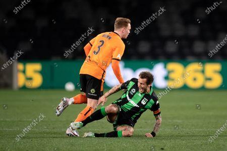 Western United midfielder Alessandro Diamanti (23) goes down injured