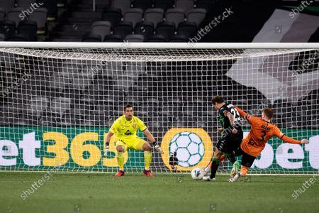 Western United midfielder Alessandro Diamanti (23) is tackled by Brisbane Roar midfielder Corey Brown (3)