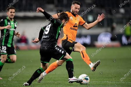 Brisbane Roar midfielder Bradden Inman (10) and Western United defender Josh Risdon (19) contest the ball