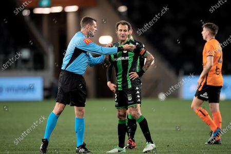 Western United midfielder Alessandro Diamanti (23) talks to the referee