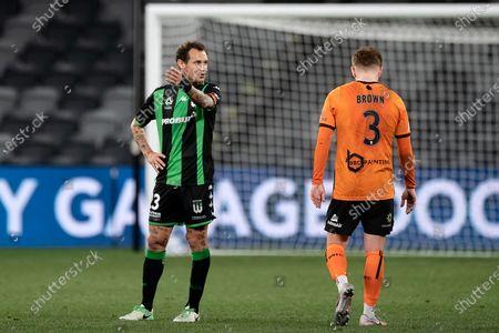 Western United midfielder Alessandro Diamanti (23) talks to Brisbane Roar midfielder Corey Brown (3)