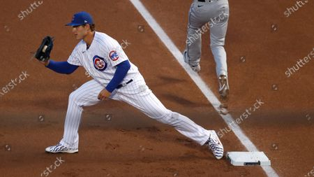 Chicago Cubs first baseman Anthony Rizzo (44) fields the throw to first base during the a baseball game against the Chicago White Sox, in Chicago. The White Sox won 7-4