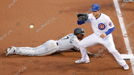 Chicago Cubs first baseman Anthony Rizzo (44) fields the throw to first base as Chicago White Sox shortstop Tim Anderson (7) dives back to the base during the a baseball game, in Chicago. The White Sox won 7-4