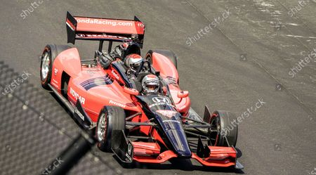 Racing great Mario Andretti drives the two seater Indy race car with his son Michael in the rear seat at the start of the 104th running of the Indianapolis 500 automobile race at the Indianapolis Motor Speedway in Indianapolis, Indiana, USA, 23 August 2020. The race is being run without the presence of fans due to concerns over Covid-19.