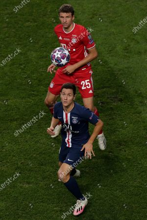 PSG's Ander Herrera, foreground, and Bayern's Thomas Mueller challenge for the ball during the Champions League final soccer match between Paris Saint-Germain and Bayern Munich at the Luz stadium in Lisbon, Portugal