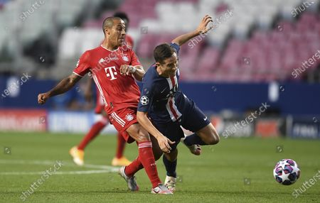 Bayern's Thiago, left, and PSG's Ander Herrera challenge for the ball during the Champions League final soccer match between Paris Saint-Germain and Bayern Munich at the Luz stadium in Lisbon, Portugal