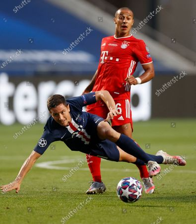 PSG's Ander Herrera, left, and Bayern's Thiago challenge for the ball during the Champions League final soccer match between Paris Saint-Germain and Bayern Munich at the Luz stadium in Lisbon, Portugal
