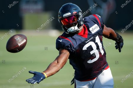 Houston Texans running back David Johnson reaches out for a ball during an NFL training camp football practice, in Houston