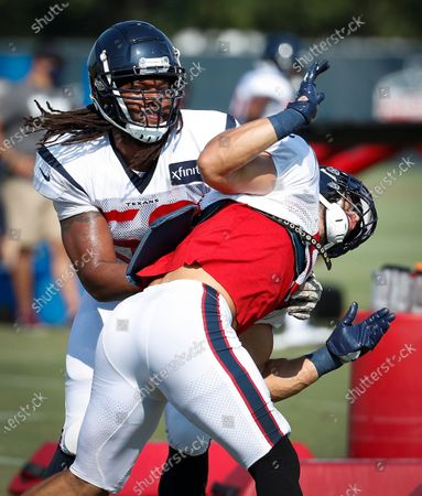 Stock Image of Houston Texans linebackers Peter Kalambayi, left, and Dylan Cole, right, work against each other during a drill during an NFL training camp football practice, in Houston