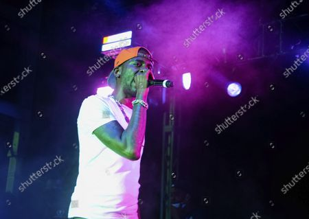 Young Dolph performs on stage at The Parking Lot Concert, in Atlanta