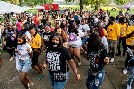 Yandy Smith, rear center, dances with attendees at Bre-B-Q Community Barbecue and Concert Honoring All The Lives Lost to Police Violence at Shawnee Park presented by Until Freedom on day two of BreonnaCon, in Louisville, KY