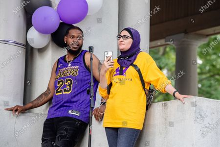 Kenny Walker, left, and Linda Sarsour attend Bre-B-Q Community Barbecue and Concert Honoring All The Lives Lost to Police Violence at Shawnee Park presented by Until Freedom on day two of BreonnaCon, in Louisville, KY