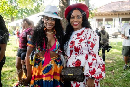Yandy Smith, left, and Tiffany Hicks pose for a photo at Bre-B-Q Community Barbecue and Concert Honoring All The Lives Lost to Police Violence at Shawnee Park presented by Until Freedom on day two of BreonnaCon, in Louisville, KY