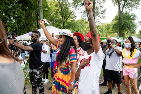 Yandy Smith, center, attends Bre-B-Q Community Barbecue and Concert Honoring All The Lives Lost to Police Violence at Shawnee Park presented by Until Freedom on day two of BreonnaCon, in Louisville, KY