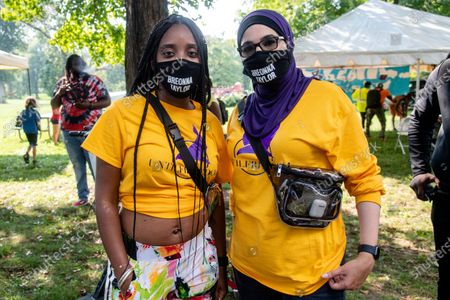 Tamika D. Mallory, left, and Linda Sarsour pose for a photo at Bre-B-Q Community Barbecue and Concert Honoring All The Lives Lost to Police Violence at Shawnee Park presented by Until Freedom on day two of BreonnaCon, in Louisville, KY