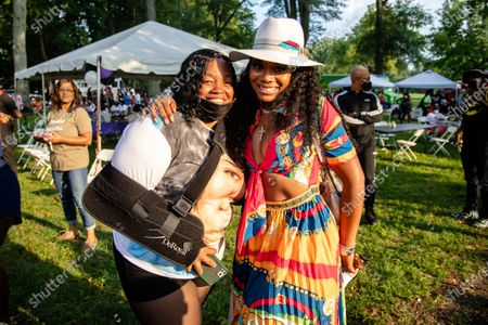 Tamika Palmer, left, and Yandy Smith pose for a photo at Bre-B-Q Community Barbecue and Concert Honoring All The Lives Lost to Police Violence at Shawnee Park presented by Until Freedom on day two of BreonnaCon, in Louisville, KY
