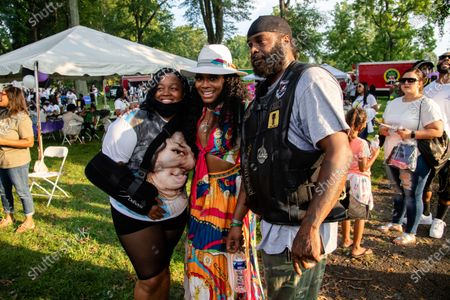 Tamika Palmer, from left, Yandy Smith and an attendee pose for a photo at Bre-B-Q Community Barbecue and Concert Honoring All The Lives Lost to Police Violence at Shawnee Park presented by Until Freedom on day two of BreonnaCon, in Louisville, KY