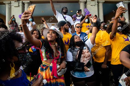 Yandy Smith, left, and Tamika Palmer dance at Bre-B-Q Community Barbecue and Concert Honoring All The Lives Lost to Police Violence at Shawnee Park presented by Until Freedom on day two of BreonnaCon, in Louisville, Ky