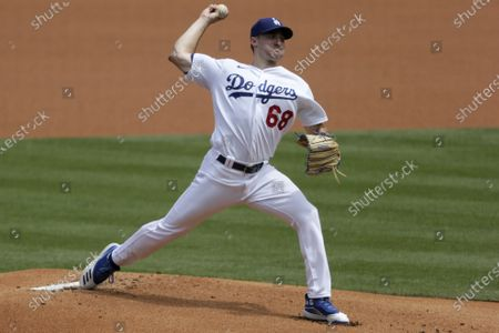 Los Angeles Dodgers starting pitcher Ross Stripling throws to the plate against the Colorado Rockies during the first inning of a baseball game in Los Angeles
