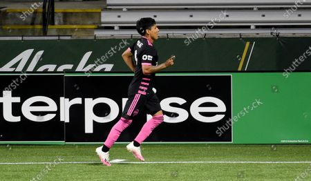 Seattle Sounders forward Raul Ruidiaz celebrates after scoring a goal during the second half of the team's MLS soccer match against the Portland Timbers in Portland, Ore