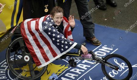 """Tatyana McFadden, of the United States, celebrates after winning the women's wheelchair division of the 122nd Boston Marathon, in Boston. McFadden is among several Paralympic athletes who are profiled in the Nexflix documentary """"Rising Phoenix"""" that will be released in 190 countries on"""