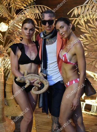 Chris Lavish center, poses with models wearing Ancora swimwear at the MAAJI Fashion Show