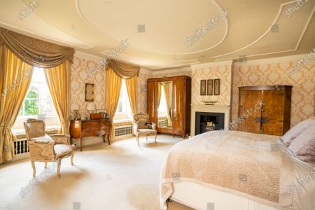 Stock Image of Master bedroom.   A stunning Georgian house that comes with its own separate office buildings including an impressive boardroom is on the market for £6.5m.  The grand-looking Tormarton Court is a classic country house with plenty of period features, set in 10 acres of grounds, perfect for those looking to escape city life.  But it also comes with an array of outbuildings ideal for setting up your business from the comfort of your back garden, making the daily commute much easier.  Nestled in the Cotswold countryside, the new owner will be in good company with billionaire entrepeneur James Dyson and the Duke of Beaufort as neighbours.