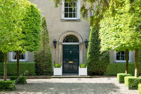The impressive entrance to the property.   A stunning Georgian house that comes with its own separate office buildings including an impressive boardroom is on the market for £6.5m.  The grand-looking Tormarton Court is a classic country house with plenty of period features, set in 10 acres of grounds, perfect for those looking to escape city life.  But it also comes with an array of outbuildings ideal for setting up your business from the comfort of your back garden, making the daily commute much easier.  Nestled in the Cotswold countryside, the new owner will be in good company with billionaire entrepeneur James Dyson and the Duke of Beaufort as neighbours.