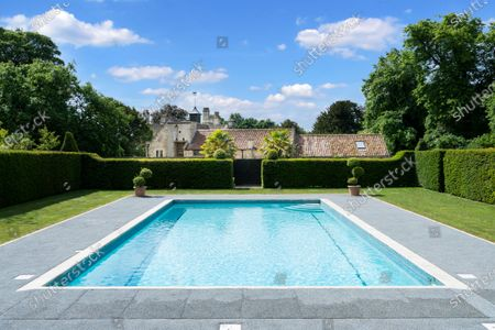 The heated outdoor swimming pool.   A stunning Georgian house that comes with its own separate office buildings including an impressive boardroom is on the market for £6.5m.  The grand-looking Tormarton Court is a classic country house with plenty of period features, set in 10 acres of grounds, perfect for those looking to escape city life.  But it also comes with an array of outbuildings ideal for setting up your business from the comfort of your back garden, making the daily commute much easier.  Nestled in the Cotswold countryside, the new owner will be in good company with billionaire entrepeneur James Dyson and the Duke of Beaufort as neighbours.