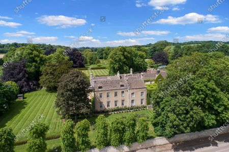 Stunning countryside setting.   A stunning Georgian house that comes with its own separate office buildings including an impressive boardroom is on the market for £6.5m.  The grand-looking Tormarton Court is a classic country house with plenty of period features, set in 10 acres of grounds, perfect for those looking to escape city life.  But it also comes with an array of outbuildings ideal for setting up your business from the comfort of your back garden, making the daily commute much easier.  Nestled in the Cotswold countryside, the new owner will be in good company with billionaire entrepeneur James Dyson and the Duke of Beaufort as neighbours.