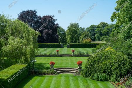 The stunning gardens.   A stunning Georgian house that comes with its own separate office buildings including an impressive boardroom is on the market for £6.5m.  The grand-looking Tormarton Court is a classic country house with plenty of period features, set in 10 acres of grounds, perfect for those looking to escape city life.  But it also comes with an array of outbuildings ideal for setting up your business from the comfort of your back garden, making the daily commute much easier.  Nestled in the Cotswold countryside, the new owner will be in good company with billionaire entrepeneur James Dyson and the Duke of Beaufort as neighbours.