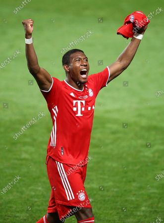 David Alaba of FC Bayern Munich celebrates following his team's victory in the UEFA Champions League Final match between Paris Saint-Germain and Bayern Munich at Estadio do Sport Lisboa e Benfica