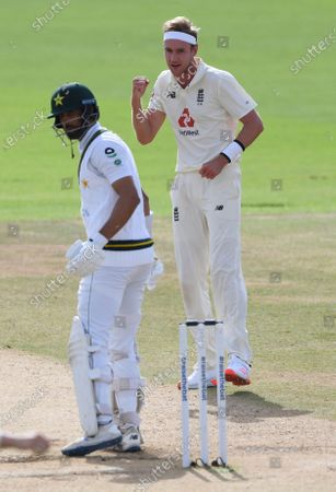 England's Stuart Broad, right, celebrates the dismissal of Pakistan's Shan Masood, left, during the fourth day of the third cricket Test match between England and Pakistan, at the Ageas Bowl in Southampton, England