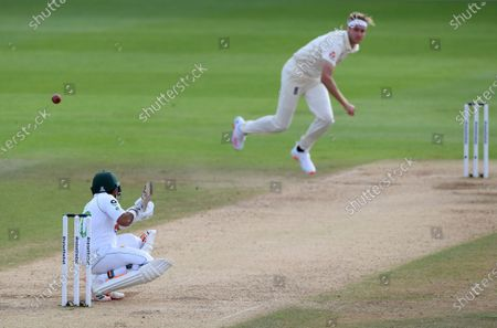 England's Stuart Broad, right, bowls a bouncer to Pakistan's Abid Ali during the fourth day of the third cricket Test match between England and Pakistan, at the Ageas Bowl in Southampton, England
