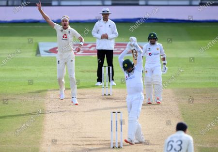 England's Stuart Broad, left, appeals unsuccessfully for the wicket of Pakistan's captain Azhar Ali, second right, during the fourth day of the third cricket Test match between England and Pakistan, at the Ageas Bowl in Southampton, England