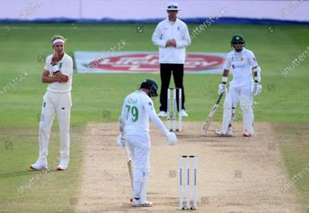 England's Stuart Broad, left, reacts after an unsuccessful appeal for the wicket of Pakistan's captain Azhar Ali, second left, during the fourth day of the third cricket Test match between England and Pakistan, at the Ageas Bowl in Southampton, England