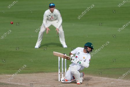 Stock Image of Pakistan's Abid Ali, front, evades a rising delivery from England's Stuart Broad during the fourth day of the third cricket Test match between England and Pakistan, at the Ageas Bowl in Southampton, England