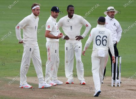 England bowlers, from left, Stuart Broad, James Anderson and Jofra Archer wait as captain Joe Root walks to talk to the umpire during the fourth day of the third cricket Test match between England and Pakistan, at the Ageas Bowl in Southampton, England