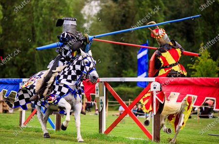 """Mediaeval jousting returned to Hever Castle and Gardens in Kent this weekend following a number of cancelled events over the summer due to Coronavirus.Actors that make up 'The Knights of Royal England' are pictured entertaining the crowds with exhilarating displays of action, stunts, falls and fights in an authentic arena complete with a Royal Box. The joust returns for the Bank Holiday next weekend. Tickets must be pre-booked in advance.Hever Castle have commented due to Covid-19:""""Normally a jousting day would attract as many as 4,500 visitors but Hever Castle is currently running at under 50% capacity on these days and our Jousting field is running at a lower capacity than this""""About Hever Castle. Dating back to the 13th century, Hever Castle was once the childhood home of Anne Boleyn, second wife of Henry VIII and Mother of Elizabeth I. It formed the unlikely backdrop to a sequence of tumultuous events that changed the course of Britain's history, monarchy and religion. The castle is also set within 125 acres of glorious grounds."""