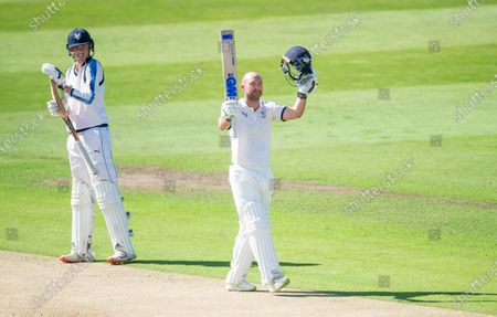 Yorkshire's George Hill looks on as Adam Lyth celebrates his century against Lancashire in the The Bob Willis Trophy.