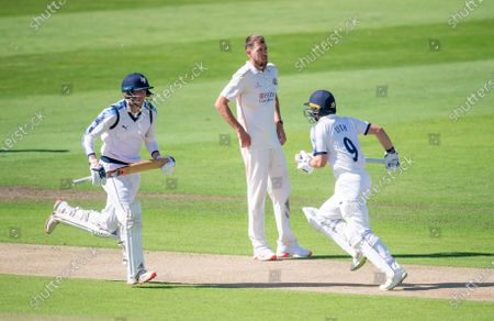 Yorkshire's George Hill & Adam Lyth take a run as Lancashire's Tom Bailey looks on in frustration.