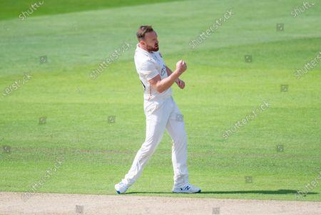 Lancashire's Danny Lamb celebrates bowling Yorkshire's George Hill.