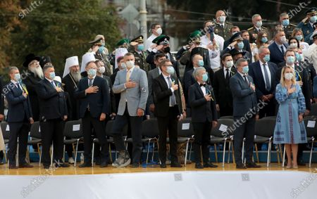 Kyiv city head Vitali Klitschko (4th L) and other guests attend the 29th Independence Day celebration in Sofiiska Square, Kyiv, capital of Ukraine.