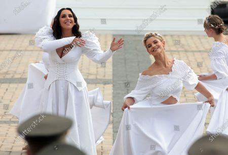 Stock Image of People's Artist of Ukraine  Jamala (L) performs during the 29th Independence Day celebration in Sofiiska Square, Kyiv, capital of Ukraine.