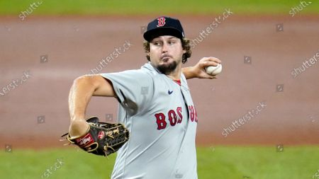 Boston Red Sox relief pitcher Josh Taylor throws a pitch to the Baltimore Orioles during the eighth inning of a baseball game, in Baltimore