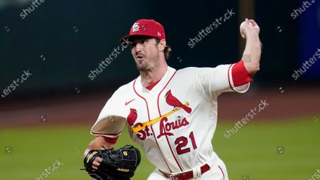St. Louis Cardinals relief pitcher Andrew Miller throws during a baseball game against the Cincinnati Reds, in St. Louis